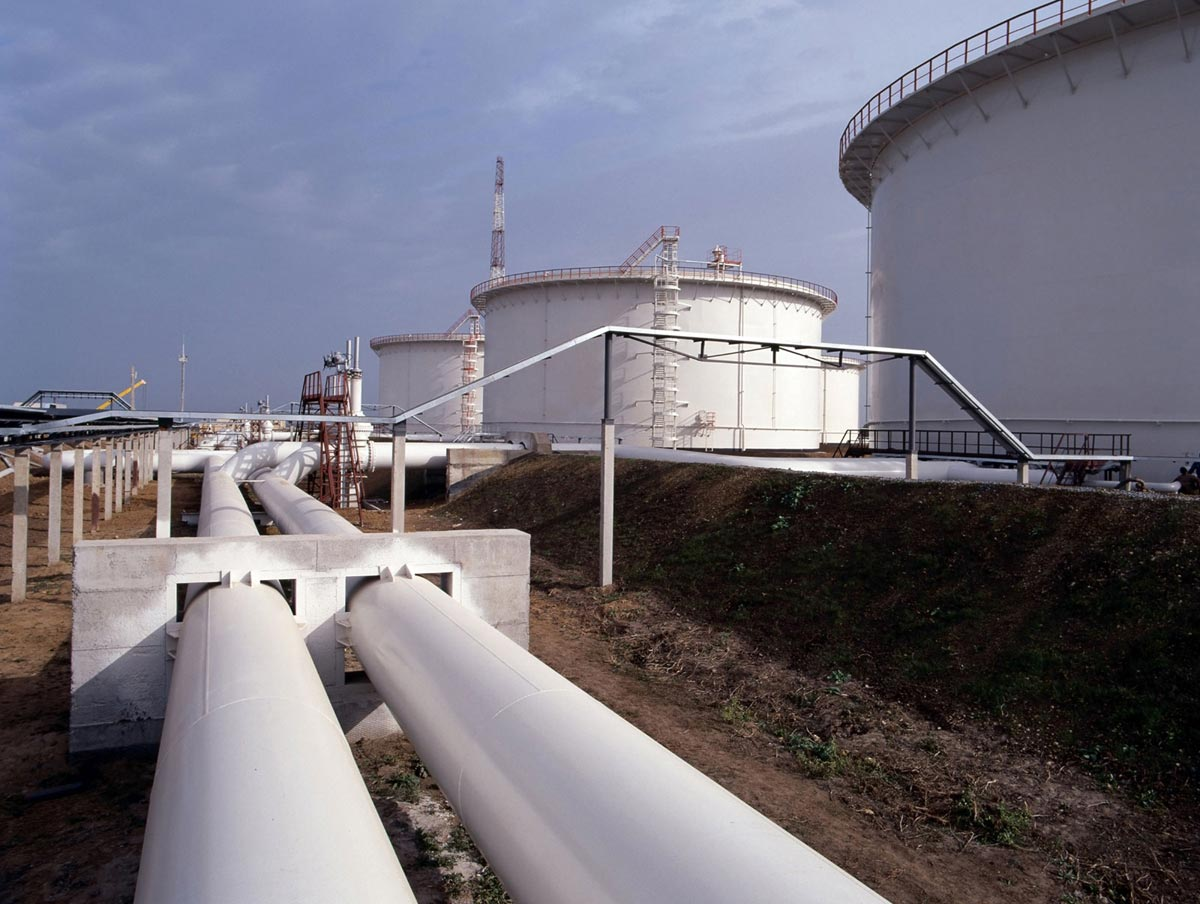 Pipes transporting oil to storage tanks